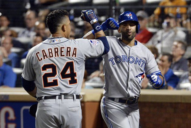 Jul 16, 2013; Flushing, NY, USA; American League infielder Miguel Cabrera (24) of the Detroit Tigers celebrates after scoring on a sacrifice fly by outfielder Jose Bautista (19) of the Toronto Blue Jays in the 2013 All Star Game at Citi Field. (Robert Deutsch-USA TODAY Sports)