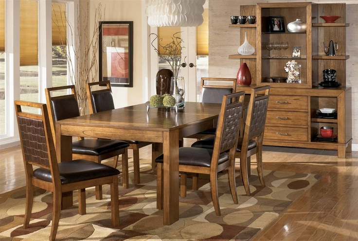 The Waurika Dining Room Table From Ashley Furniture HomeStore AFHS Rich Rustic Design Of Collection Features A Warm