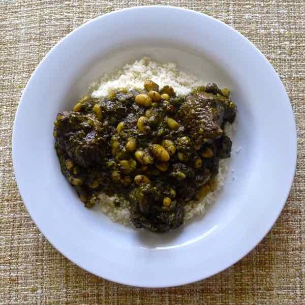 Pkaila is the most famous Jewish Tunisian dish. This beef stew, prepared with fried spinach and white beans, is often served with couscous.