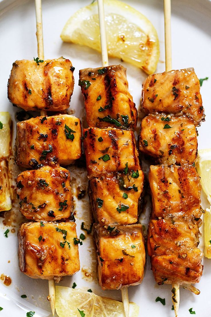 Lemon Garlic Butter Salmon Skewers are easy, healthy, and so fun to make. Cubed salmon is marinated with a tangy sweet honey lemon garlic butter sauce and threaded onto skewers before jumping right on the grill. eatwell101.com