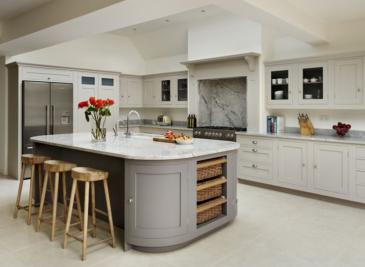A lovely neutral colour palette in this modern kitchen. This is the Harvey Jones Shaker kitchen with curved cupboards, painted in Little Green Paint Company French Grey and Dark Lead. www.harveyjones.com, www.littlegreene.com