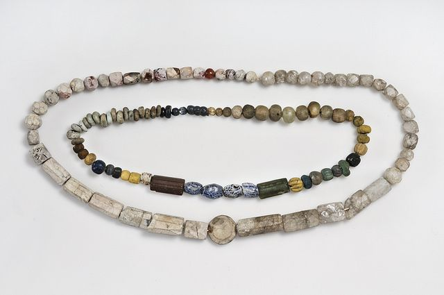 """Beads. Glass, rock crystal and carnelian. The beads are from a cremation context. The heat from the pyre has turned the carnelian beads """"bone white."""" Grave find, Björkö, Adelsö, Uppland, Sweden. SHM 34000:Bj 151.  In the Historiska Museet, Stockholm."""