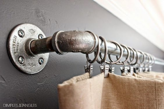 For an inexpensive DIY curtain rod alternative, consider using galvanized pipe.  Great for an industrial look or a boy's room. Seen here from DimplesandTangles.blogspot.com | thisoldhouse.com: