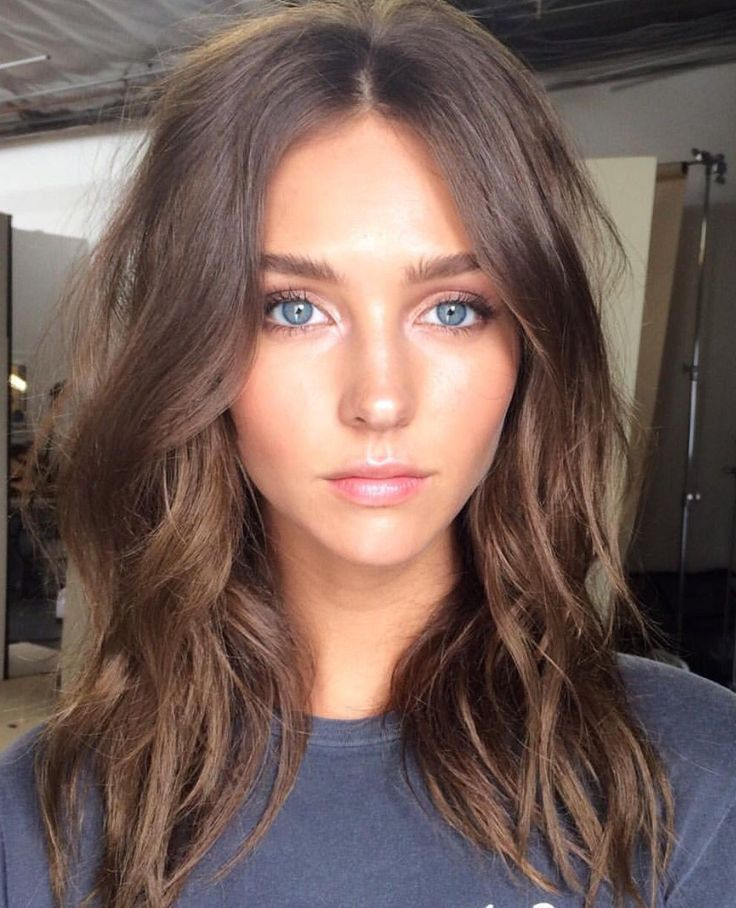A Beautiful Girl With Blue Eyes Brown Hair Shoulder Length Hair