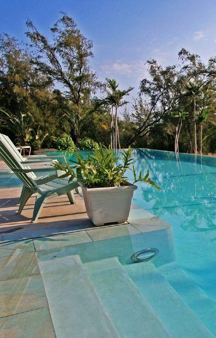 Eco-conscious holistic hideaway on a lush estate along the Big Island's North Kohala coast.