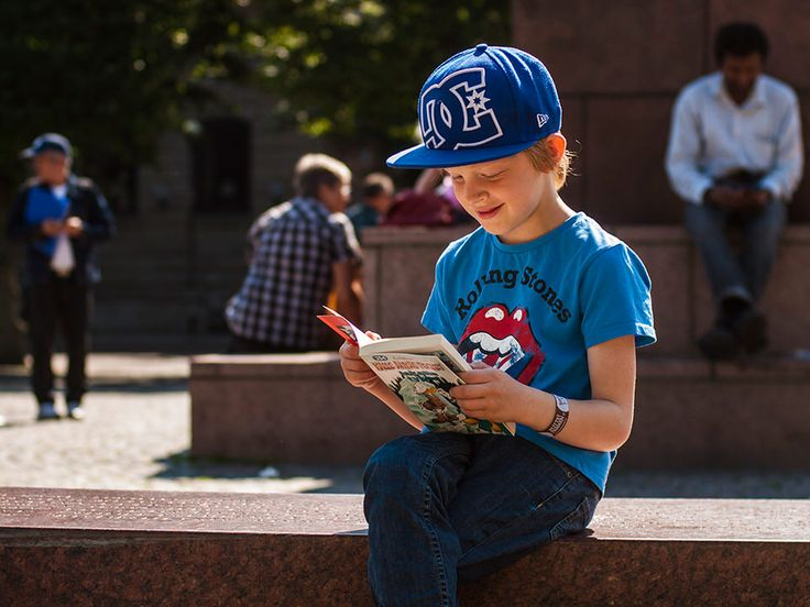 Rolling Stones #photography #streetphotography #reading #books #kids #literature #blue #rollingStones Reading Sweden - Marxal