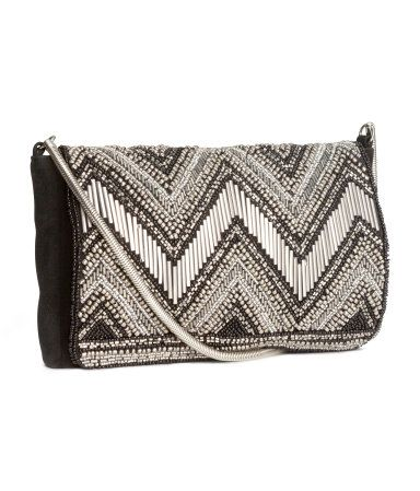 Beaded Clutch Bag Small clutch bag in imitation suede with beaded embroidery. Metal chain shoulder strap H&M US