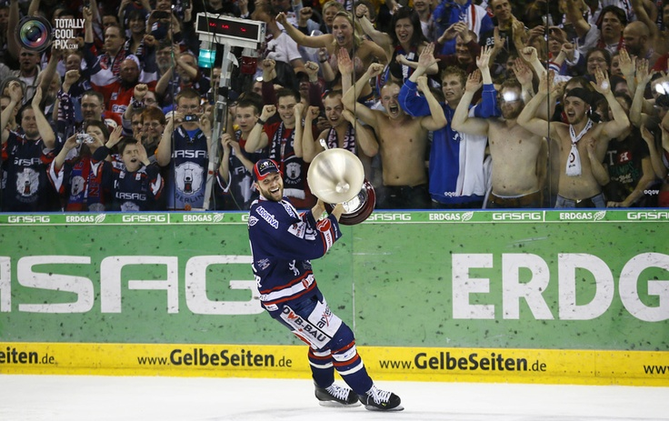 Regehr, team captain of new German champion Eisbaeren Berlin, celebrates with the trophy after their victory against Adler Mannheim in Berlin