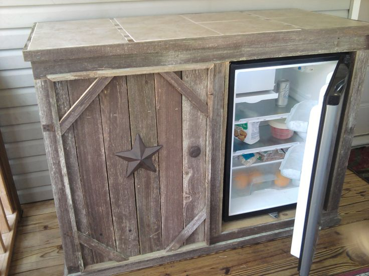 deck cabinet with refrigerator open door tile top