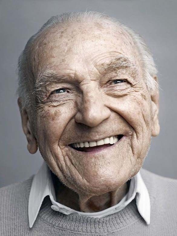 This man is smiling because he has lived almost a century ~