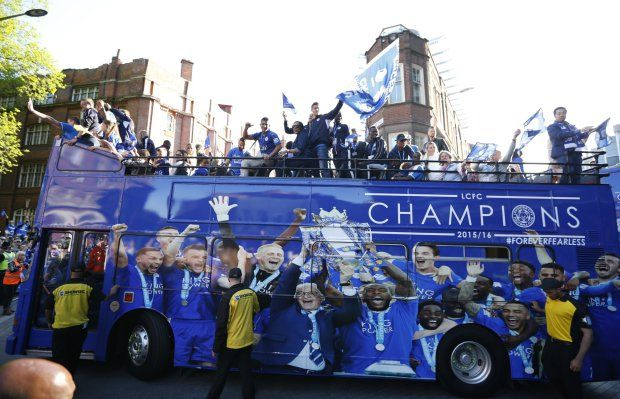 Britain Football Soccer - Leicester City - Premier League Title Winners Parade - Leicester City - 16/5/16 Leicester City celebrate with the trophy on the bus during the parade Reuters / Phil Noble Livepic EDITORIAL USE ONLY.