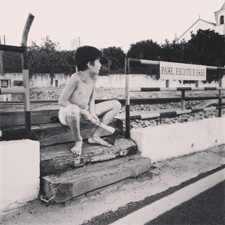 Máximo boy with an axe sits