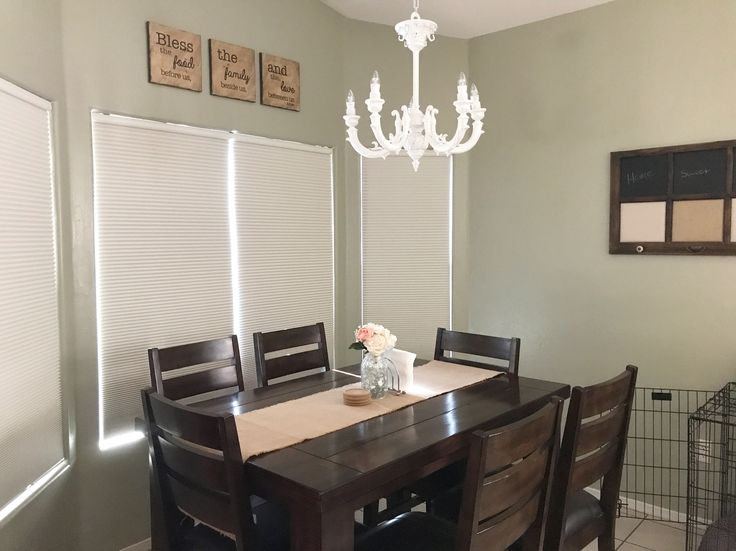 Dinning room makeover... Wall color: Sherwin Williams Svelte Sage; antique chandelier; farmhouse