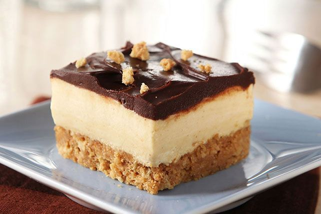 A cookie crust is topped with layers of creamy peanut butter and chocolate—elevating these squares from a candy store favorite to an elegant delight.