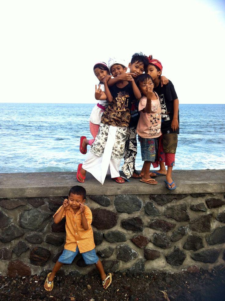 Happy kids playing on the beach of Jasri, Karangasem region, Bali.
