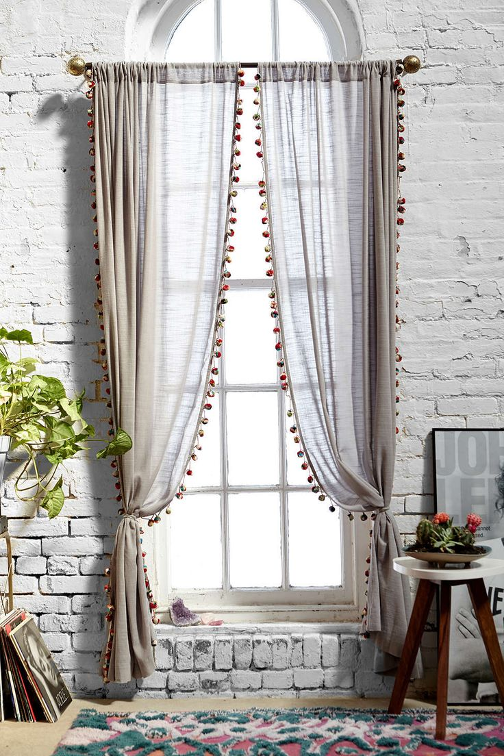 Magical Thinking Pompom Curtain--Urban Outfitters is impressing me! Although some of the reviews on their home decor items are a little frightening!