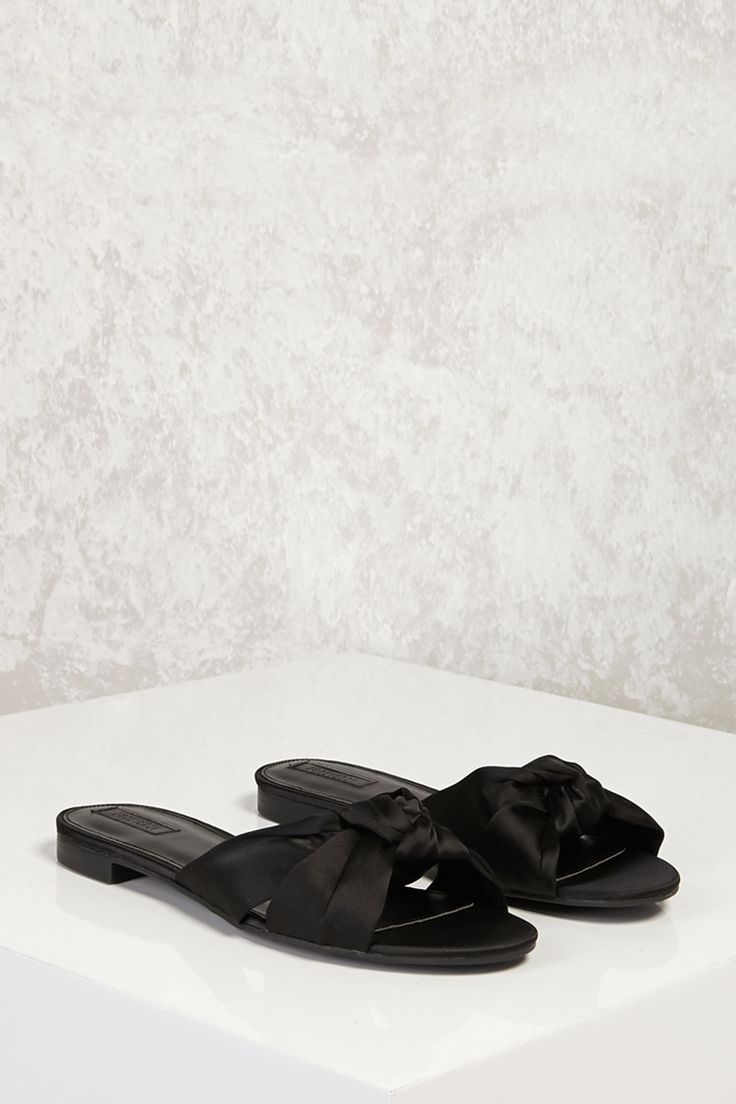 f550226aa8fd A pair of satin slide sandals featuring an open toe