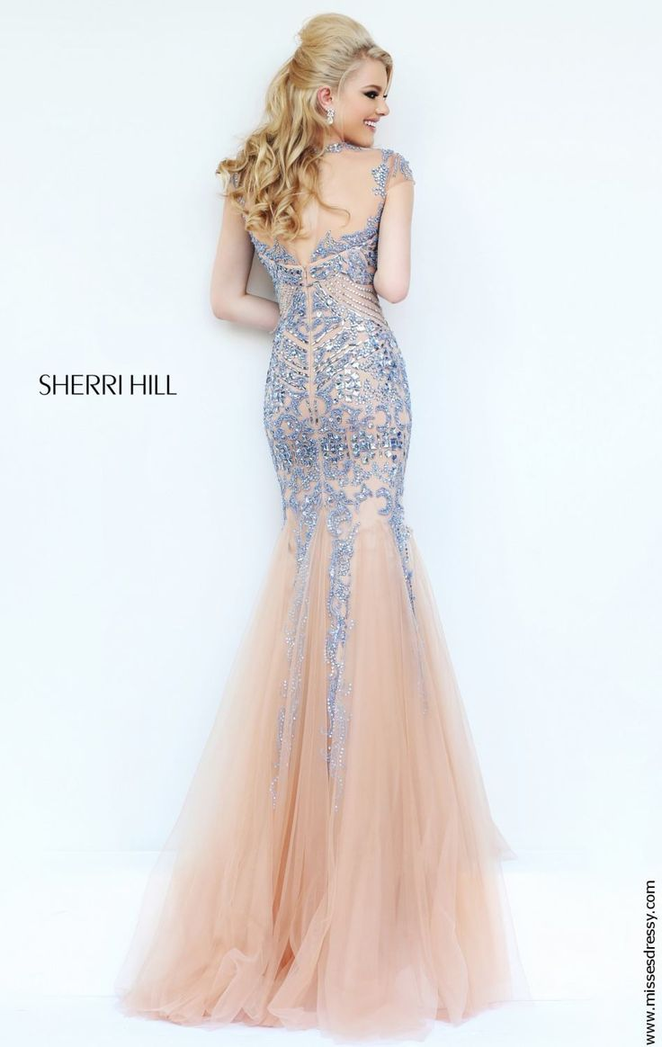 Dazzle and shine in this radiant evening dress from Sherri Hill The  illusion bodice has elegant cap sleeves and shines with a stunning array of  sparkling