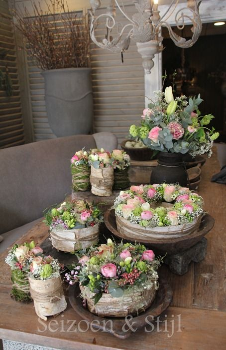 Charming Florals. I wonder how/where you could get the bark, but that would look great around potted plants!