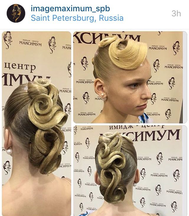 Low swirl bun hairstyle with big swirls from the front/top going to the bun