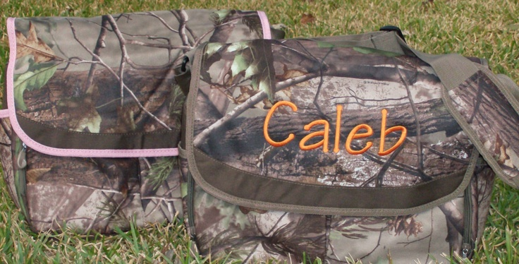 Personalized messanger style real tree camo diaper bag. $39.00, via Etsy.