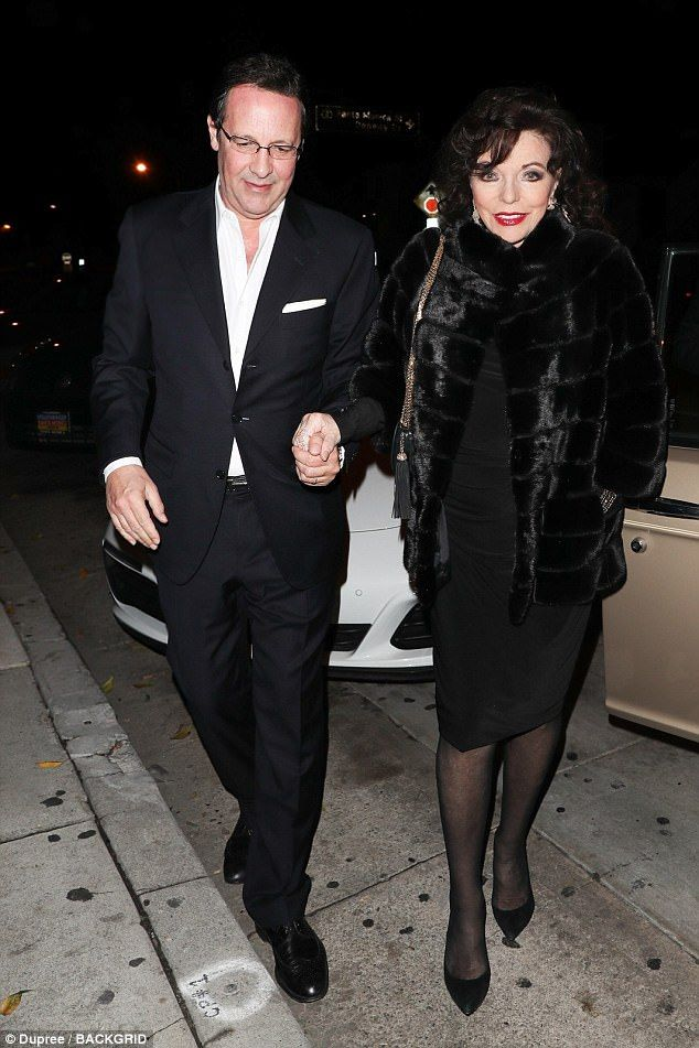 Love is fur-ever! Joan Collins, 84, exuded Hollywood glamour in an elegant dress and styli...