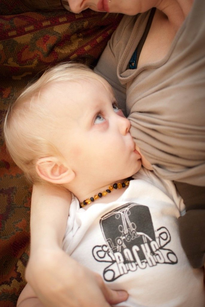Breastfeeding Toddler Boy Wearing A Cloth Diapers Rocks