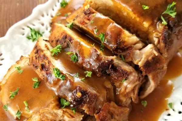 Butter-Braised Slow Cooker Pork Roast   A fork-tender pork loin drenched in sizzling butter seasoned with Cajun spices cooked to crispy perfection in the crock pot.