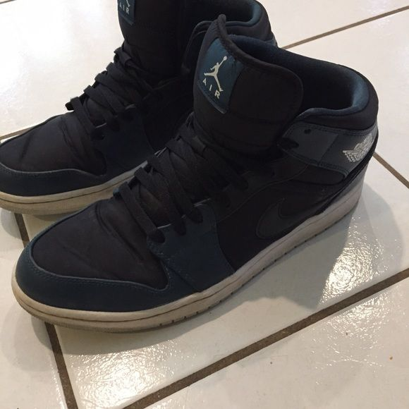 Air Jordan 1 Mid Mens casual shoe Fairly worn Black/Navy Nike mens size 12.5 (comfortably fits size 13). Open to negotiations. Jordan Shoes