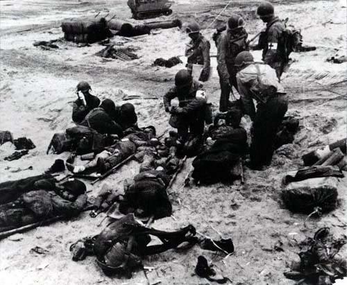 D-Day: The Normandy Invasion. Medics attend to wounded soldiers on Utah Beach in France during the Allied Invasion of Europe on D-Day, June 6, 1944. www.army.mil/d-day