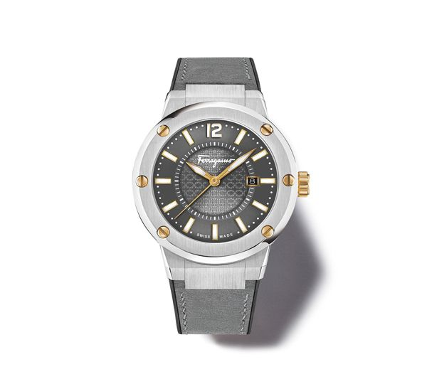 44 mm stainless steel case with gold IP decorative screws on top ring. Smoky grey guilloché dial with luminescent indexes and hands. Quartz movement. Grey calf combined with black caoutchouc strap and deployant buckle. Anti-reflection, scratch-resistant sapphire crystal. Water resistant to 100 m. Two-year warranty. Swiss Made.