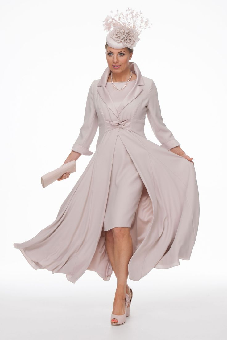 Make an entrance in this stunning full skirted coat and dress. The coat has lots of movement and teamed with the short straight dress has a contemporary look . As always the outfit is made to measure in a choice of colours . The matching hat is by Scottish millinery designer William Chambers.