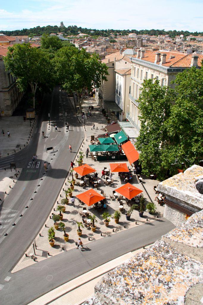 La Bourse & La Tour Magne on the hill, view from Arena, Nîmes, France | Matthieu Dalmasse