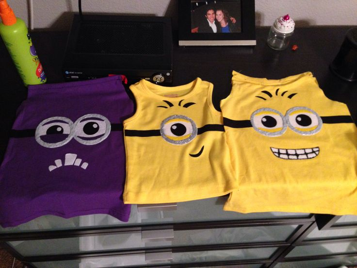 DIY minion shirts. Felt, black material, silver fabric paint, heat and bond ultra, and a lot of patience.