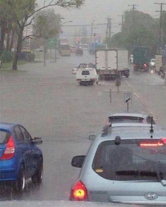 Drivers take on flooded roads as heavy rain hits Brisbane. Brisbane weather: Rain causes