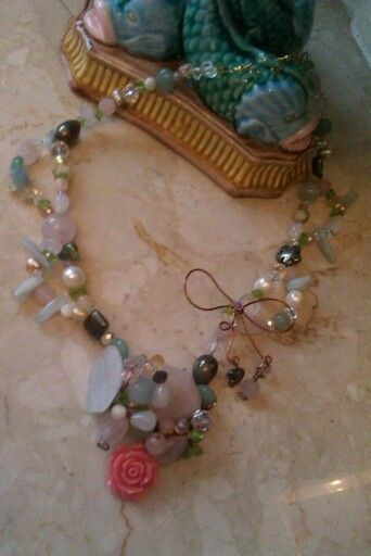 Handmade mix gem cluster necklace the gammered copper eire bow.  £35