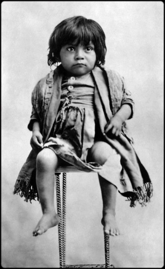 An Apache girl. A little girl in a tattered dress. Many people put Native Americans in this kind of spiritual, euphoric, wonder world, but in reality they have the same needs as all of us. Shelter, food and love. To live like a Native American in the 1800's would have been a hard life. . Photo 1883.
