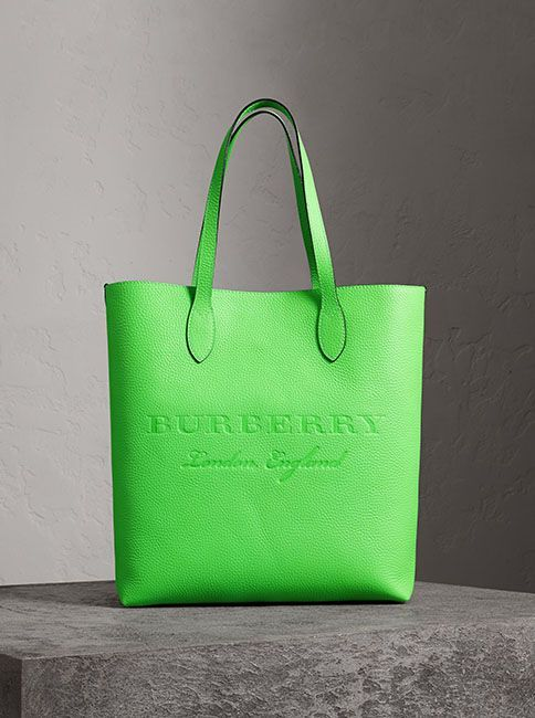 60fe060a3eb2 A versatile leather tote by Burberry in a vibrant neon hue with an interior  zip pocket for small essentials. The softly structured design is finished  with ...
