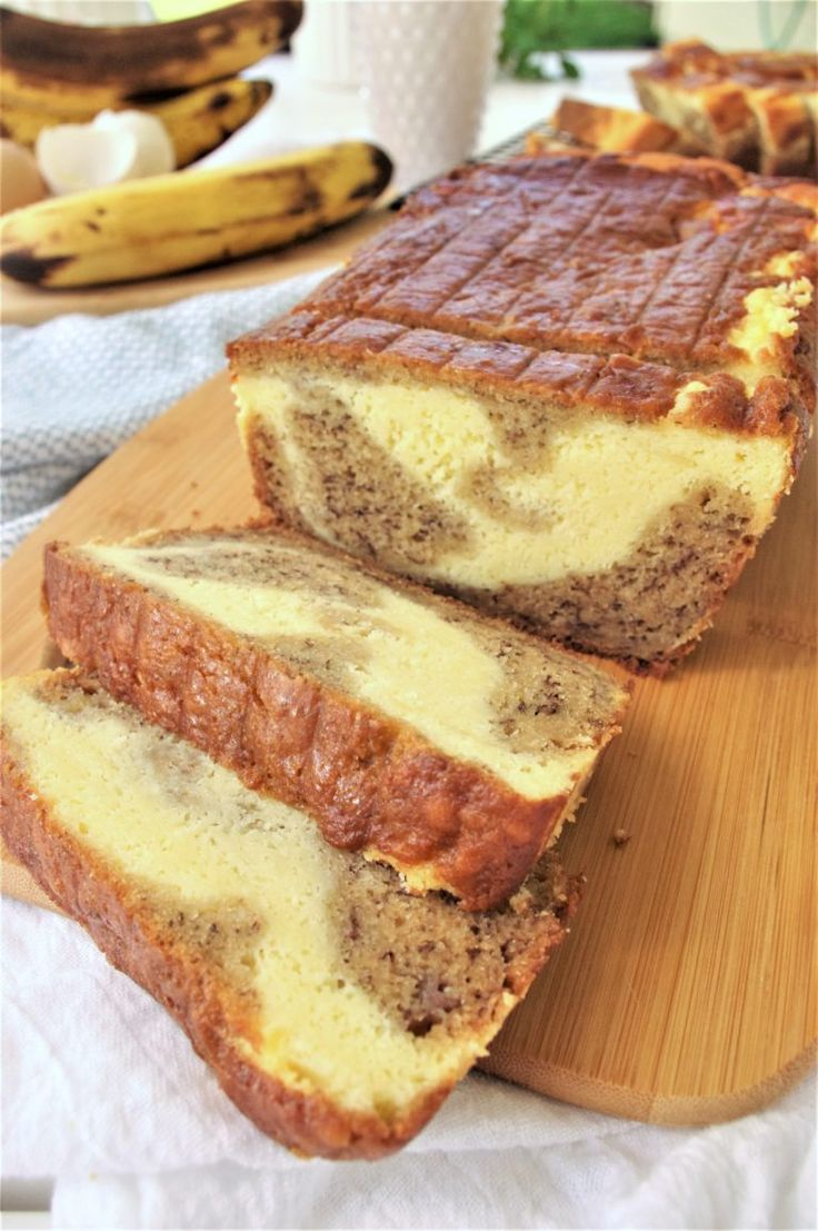 Easy Quick Cream Cheese Swirled Banana Dessert Bread made with Greek Yogurt Recipe - so moist and yummy - This is the BEST banana bread franken recipe we've ever conjured up (and we've tried a bagillion and a half). It turns out with perfect yummy texture and flavors. To tip the scales from delish to perfection - it's swirled with scrumptious cream cheese filling elevating it from yummy snack to irresistible dessert status! by Dreaming in DIY