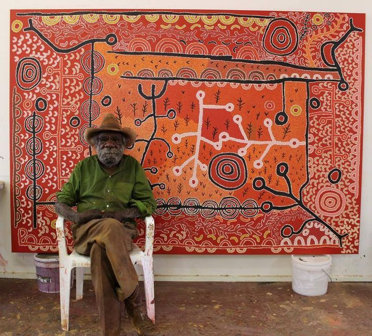 Painting legend Peter Mungkuri with his completed work Ngura (Country) now showing at Salon des Refusés in Darwin