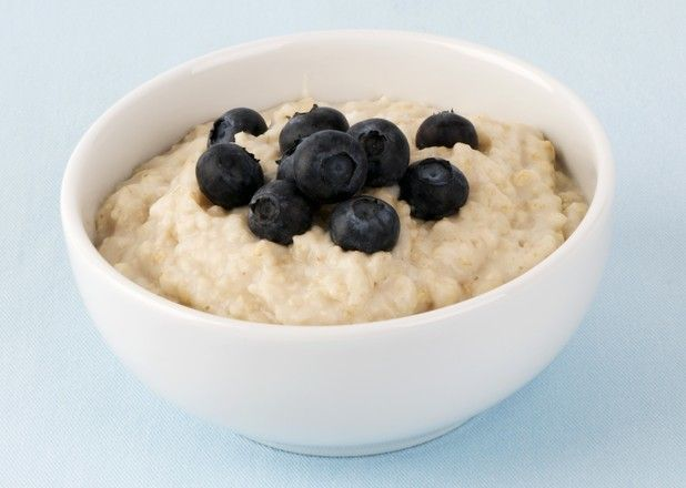 09 Mar 2009 --- A bowl of porridge with fresh blueberries --- Image by © the food passionates/Corbis