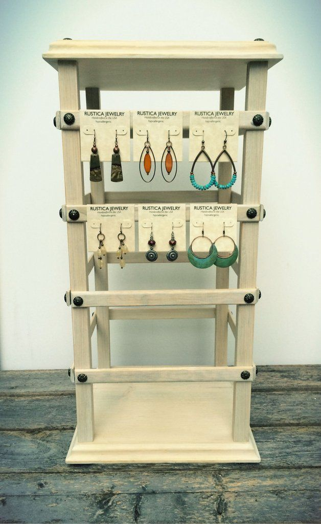 "4-sided wholesale jewelry display with rotating base, made from select pine wood and finished in a classic ""whitewash"" finish and sealed with paste wax. ""The Grand Stand"" has several slats to hang you"