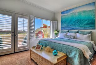 Tropical Guest Bedroom with Carpet, Distressed pine finish wood bedroom bench cedar chest, French doors, Crown molding
