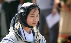Liu Yang, China's first female astronaut, makes her way to board the Shenzhou-9 spacecraft    Photograph by STR/AFP/Getty Images.