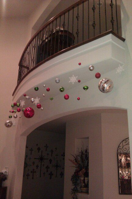 Fishing line and ornaments! Instead I would hang from curtain rods easier for me to do lol!