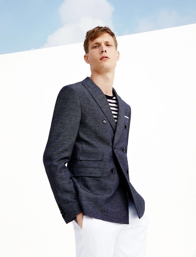 Classic summer: double-breasted jacket, nautical stripe top, white pants.