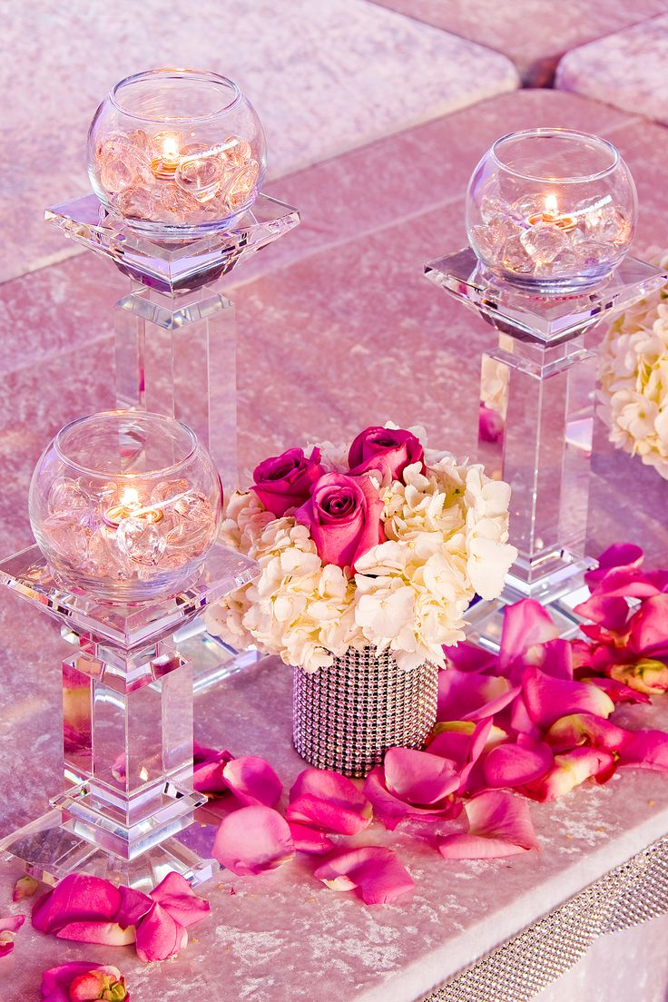 Pink themed party flowers with candle accent designing