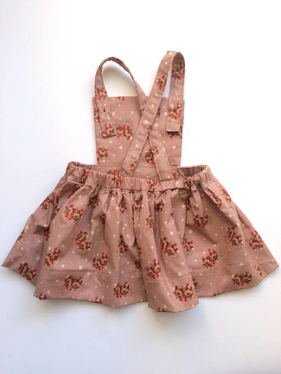 This dress is vintage inspired and is perfect for layering in the fall or to wear in the spring over a little tshirt! Two options for length: Vintage length is about 3in shorter than knee length. I reccomment getting the vintage length for younger babies, & pairing it with a
