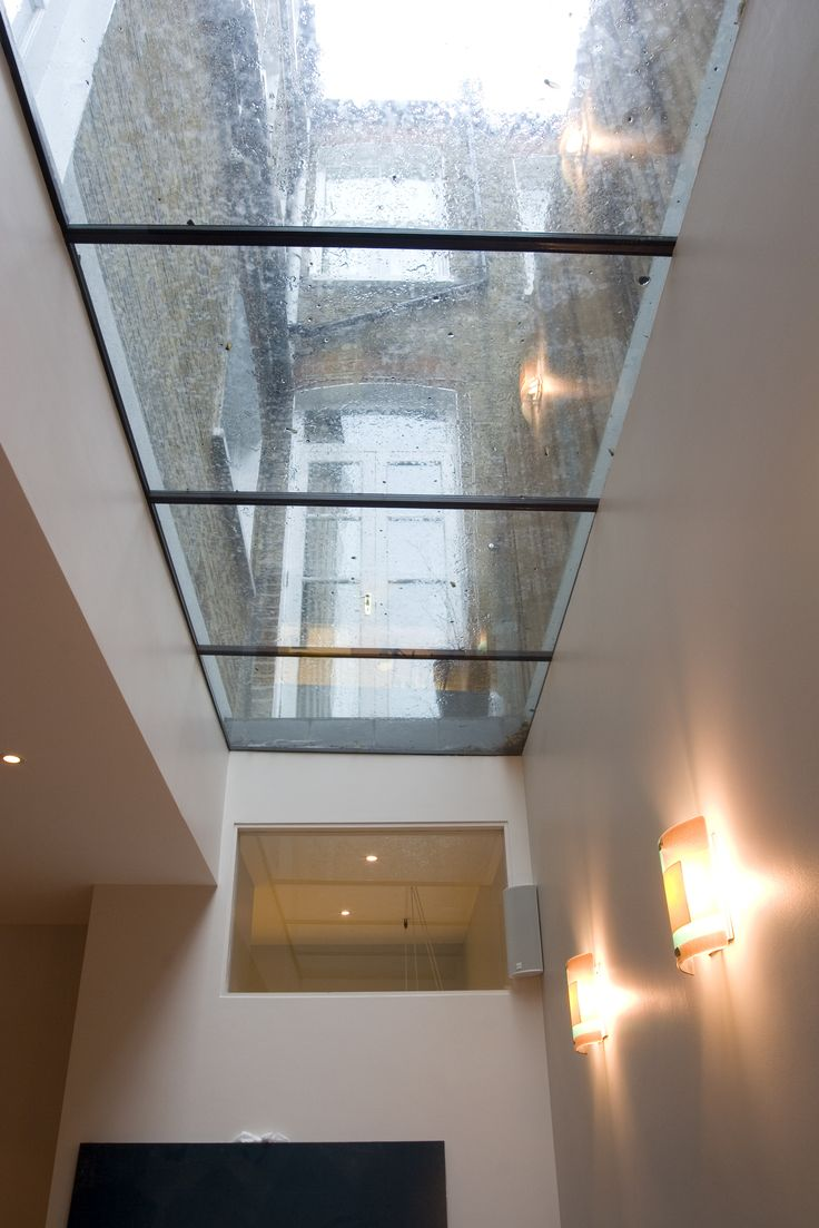 A lightwell shown from the inside, with walkable glass, below the side return in this Victorian House.