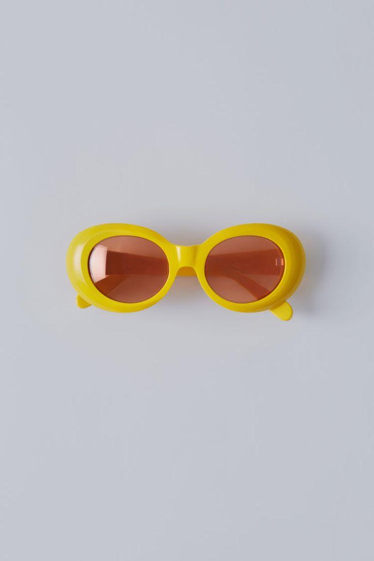 Acne Studios Mustang yellow/orange mirror are handmade oval frame acetate eyewear.